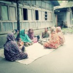 Women gather in the courtyard near their homes to discuss nutrition with project staff.