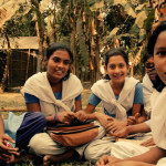 A group of girls, different ages, sit and talk about the first time they heard about menstruation.