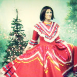 "Martina shows off a handmade vintage Mexican gown at ""Chestnuts"" antique store in Suttons Bay, Michigan."